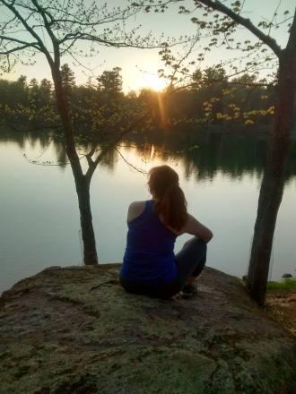 Moriah admiring sunset close to Baker Mountain in Saranac Lake, New York